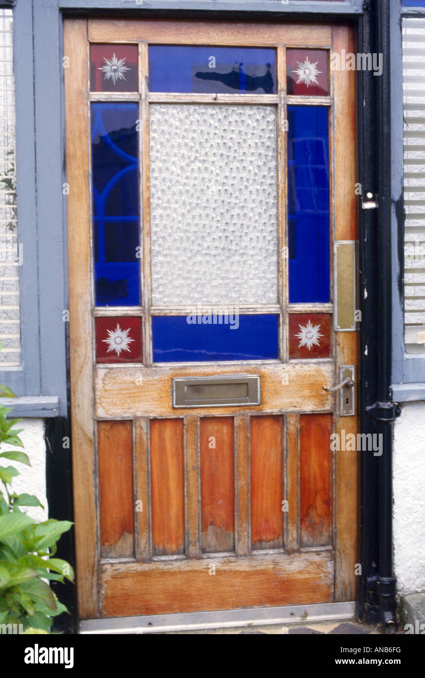 Close up of front door with blue and red victorian stained glass close up of front door with blue and red victorian stained glass rubansaba