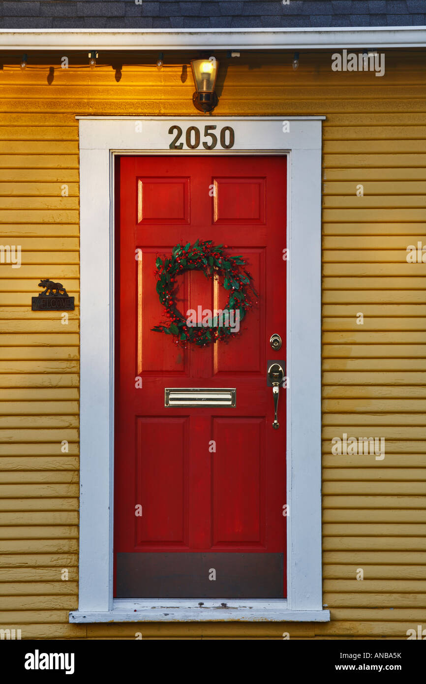 Christmas Holly Wreath On Distinctive Red Door And Yellow Trimmed House Victoria British Columbia Canada