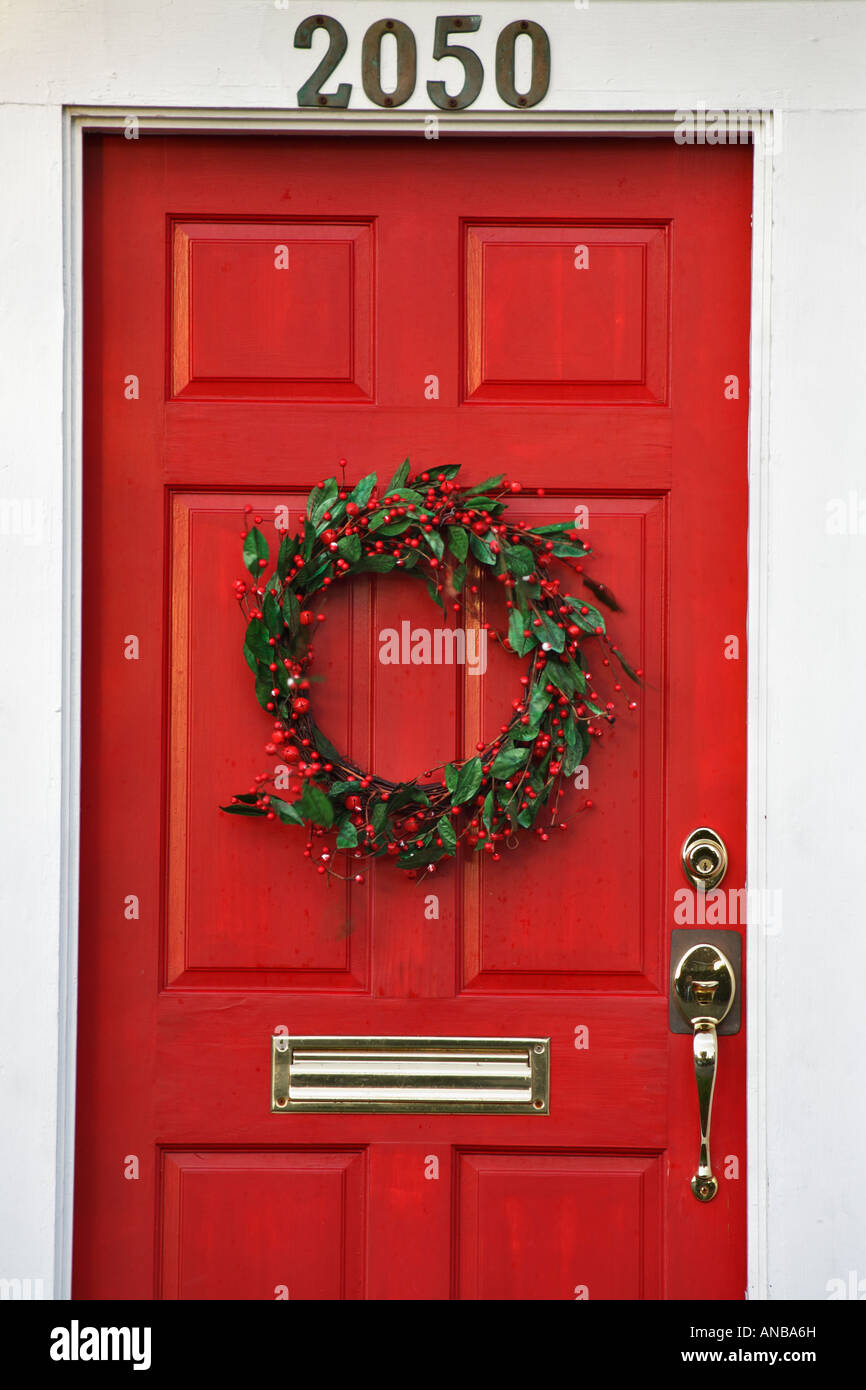 Christmas Holly Wreath On Distinctive Red Door Of Residential Home Victoria British Columbia Canada