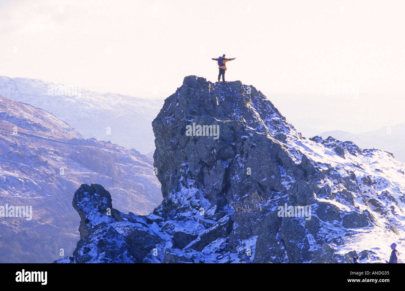 the lion and the lamb helm crag winter summit cumbria stock photo