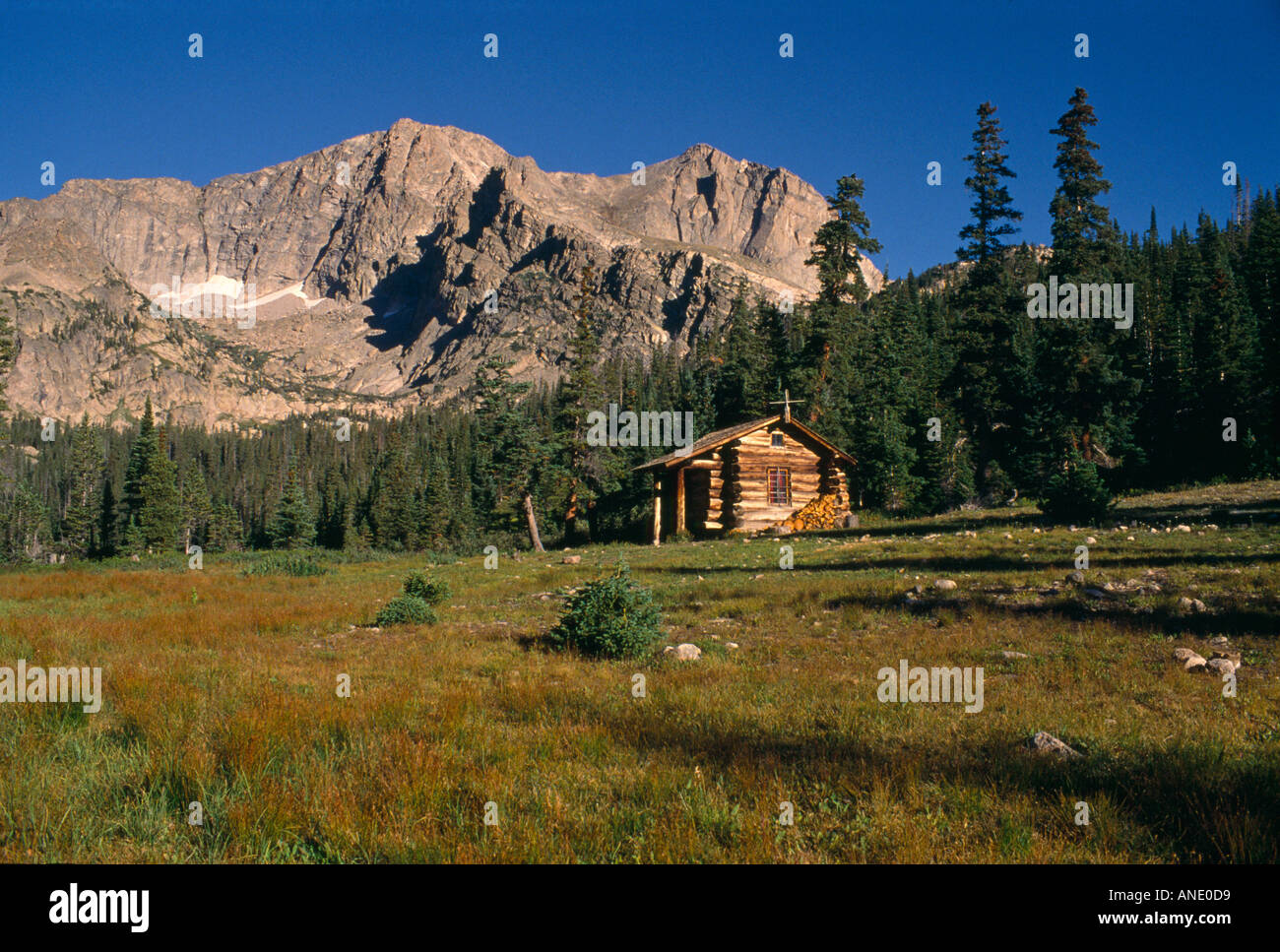 A Rustic Cabin Sits Beneath Mt Alice Near Thunder Lake In