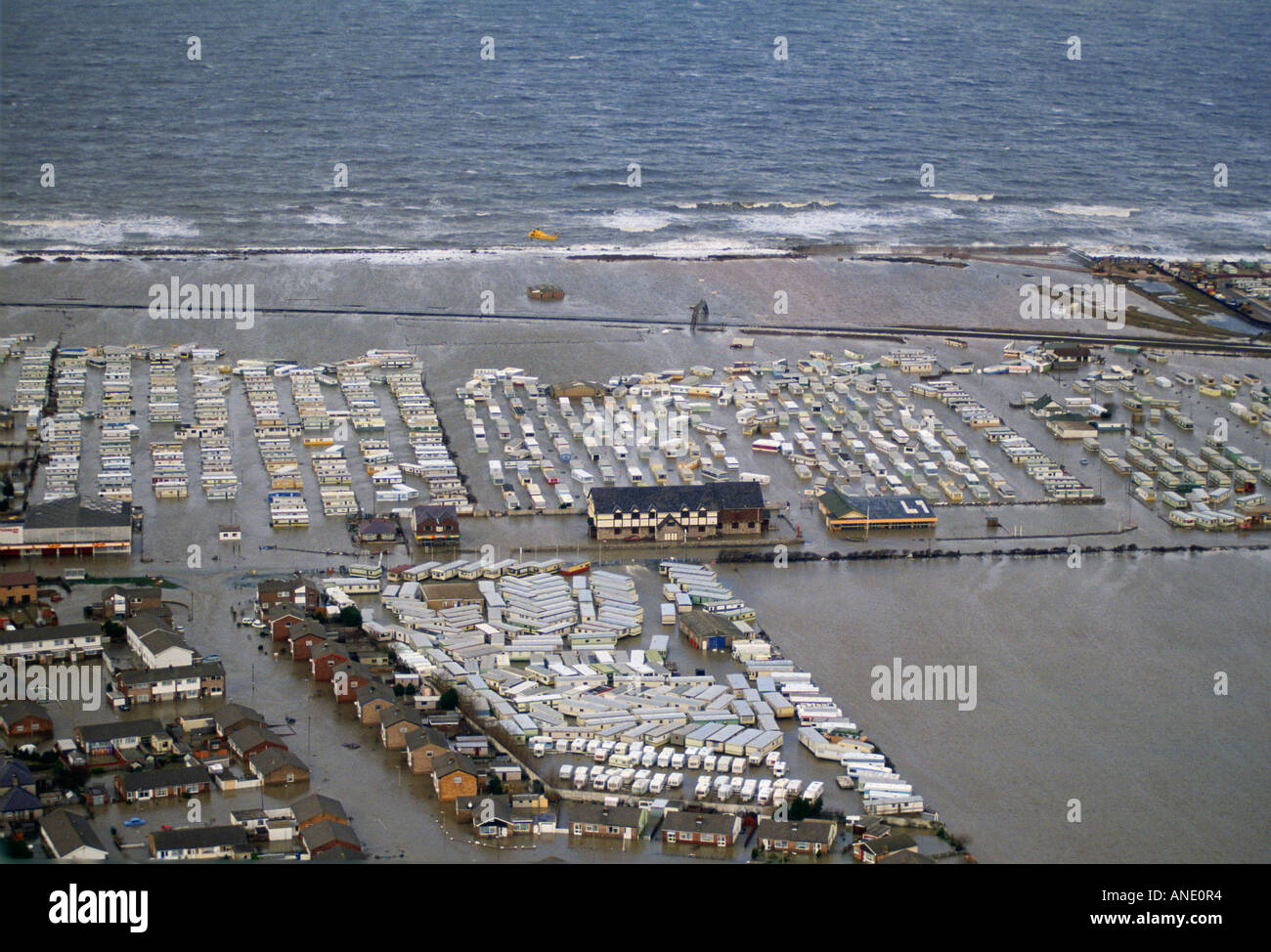 Houses and caravans in the flooded town of Towyn in North ...