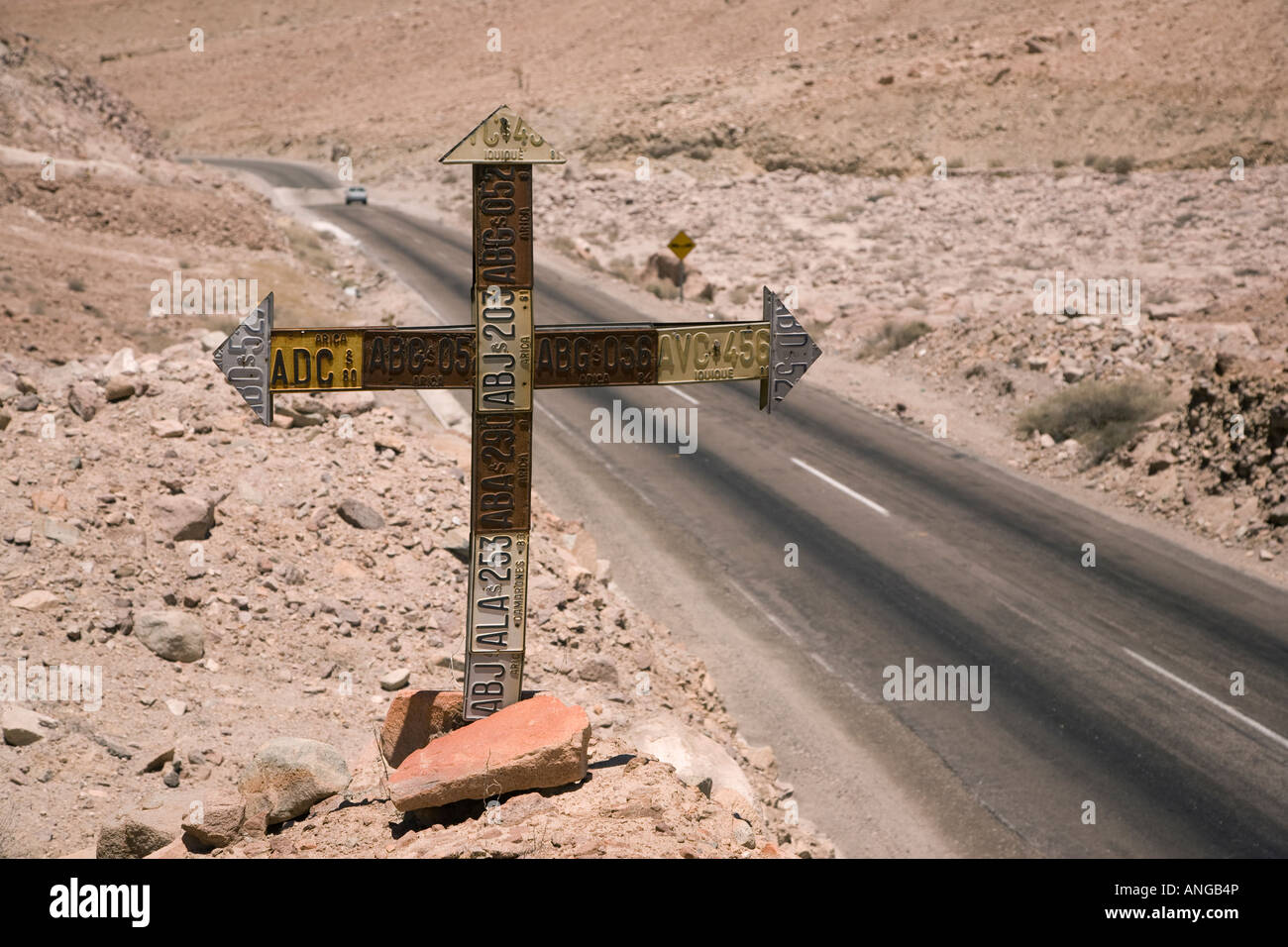 Roadside cross made with old car registration plates along Highway ...