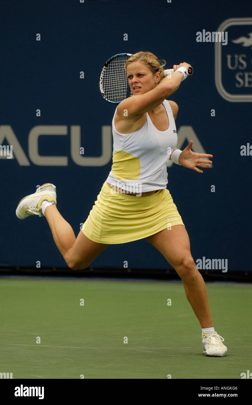 Kim Clijsters hits a forehand against Maria Sharapova in the