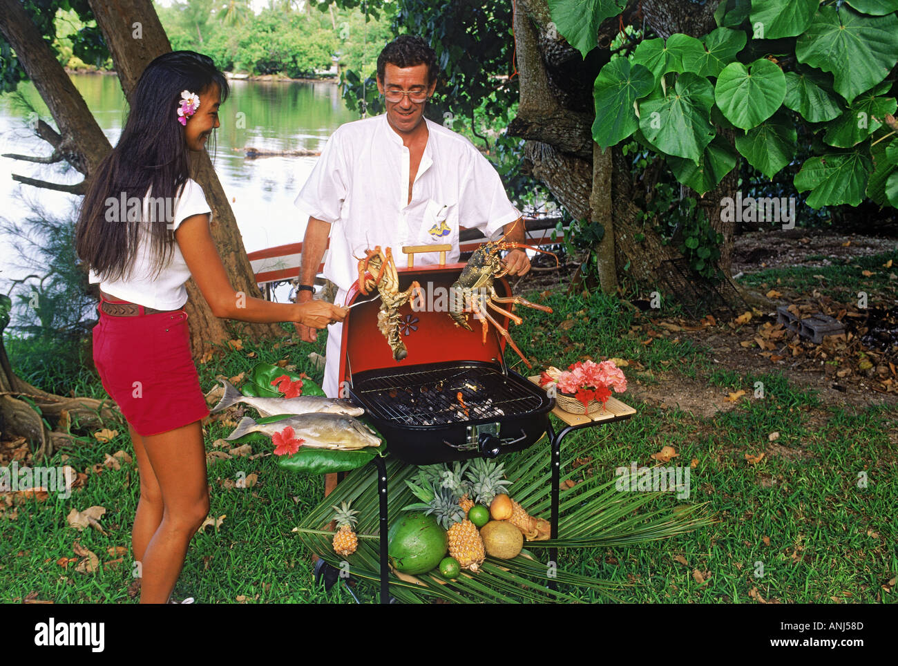friends grilling lobster on backyard barbecue or grill in french