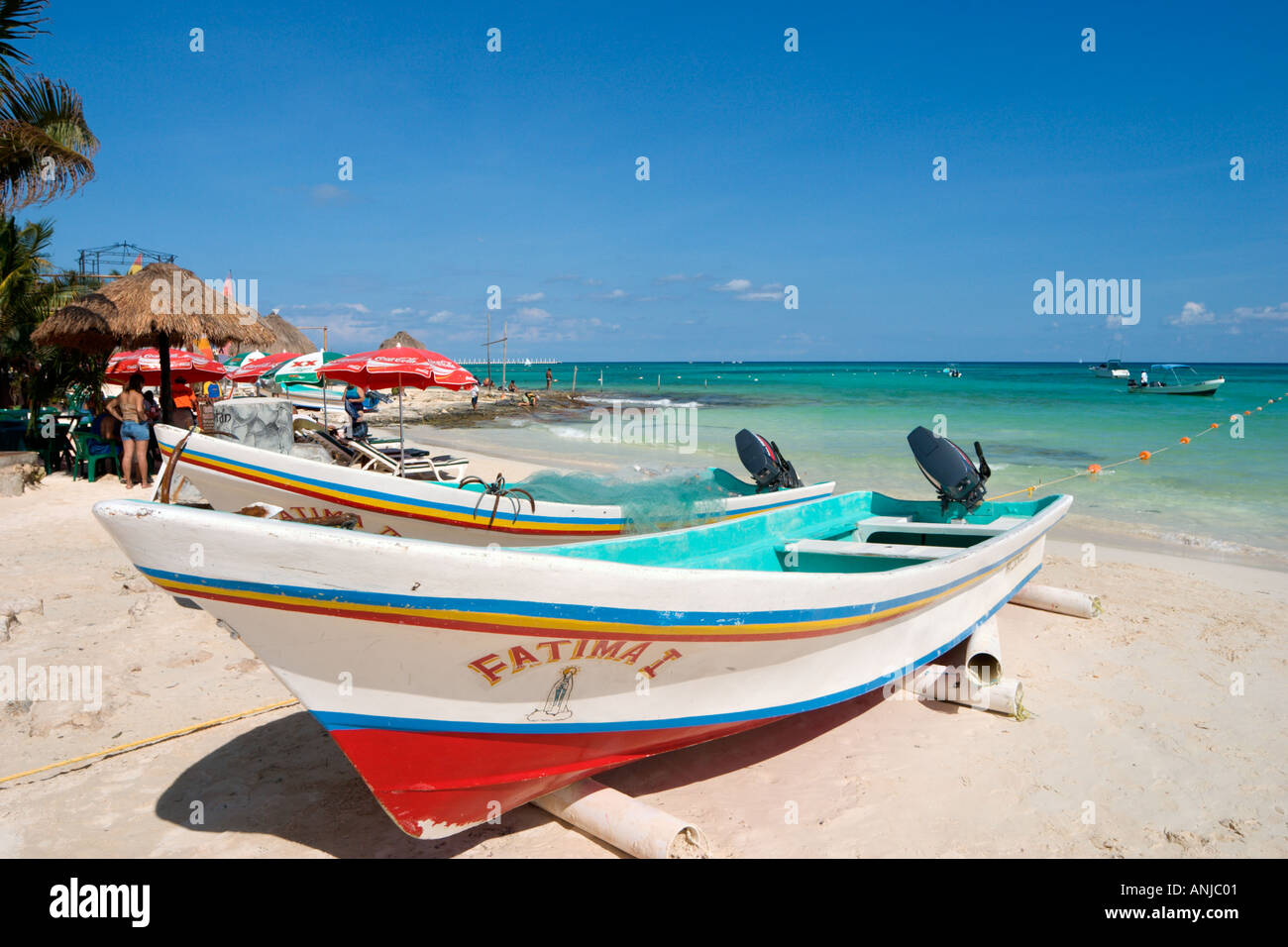 Fishing boat on the beach in the resort centre playa del for Riviera maya fishing
