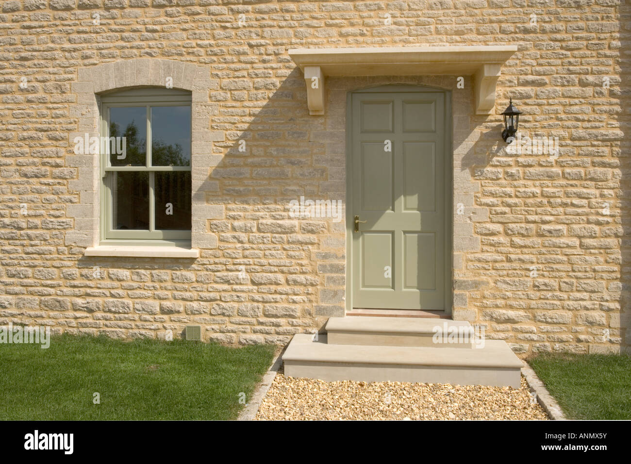 New House Build Painted Front Door In Stone Wall Stock