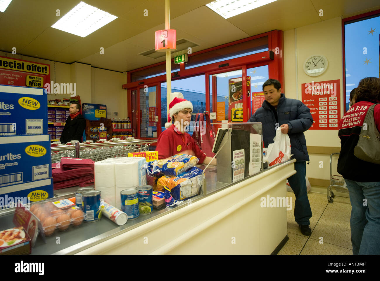 checkout worker at frozen food supermarket store working checkout worker at frozen food supermarket store working on christmas eve aberystwyth uk