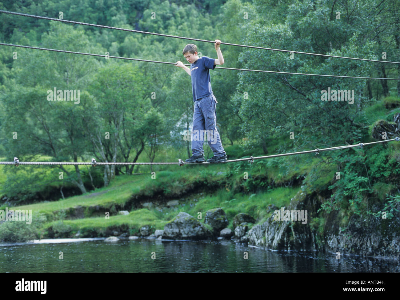Boy on wire rope bridge Glen Nevis Scotland Stock Photo, Royalty ...