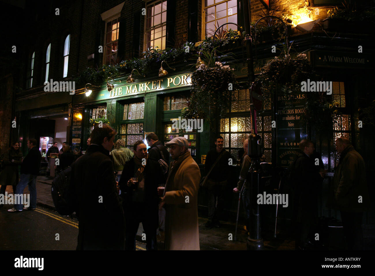 Drinkers stand outside the market porter pub borough for Stand pub