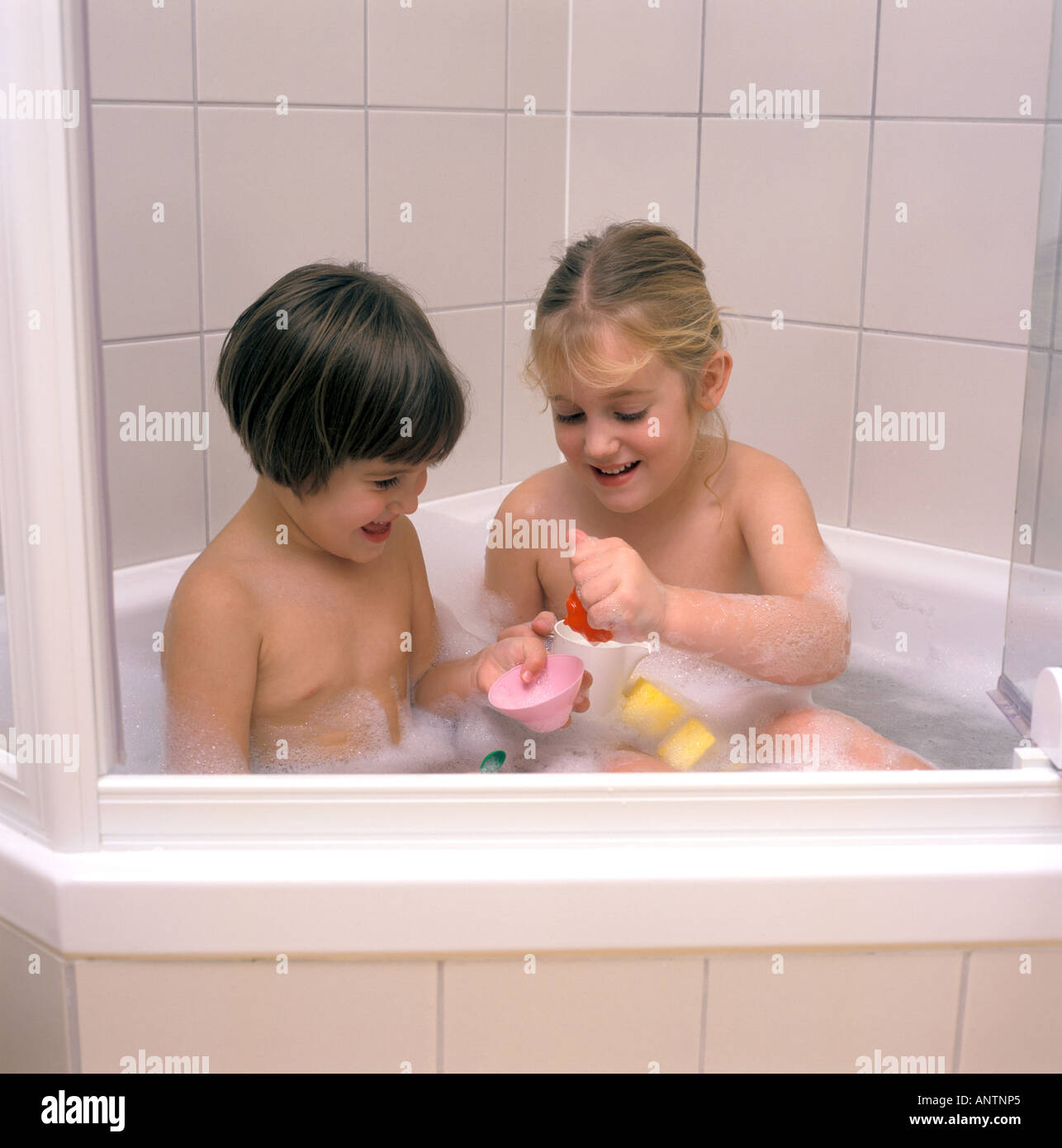 Stock Photo   Two Girls In The Bathroom
