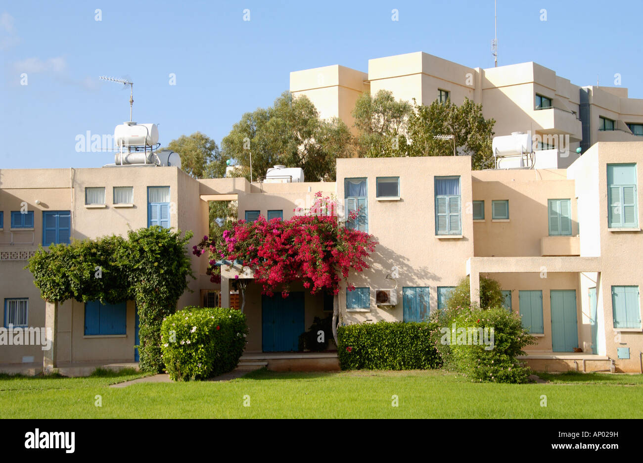 Holiday homes and apartments at Pernera on the Mediterranean island of  Cyprus EU with grass area in front