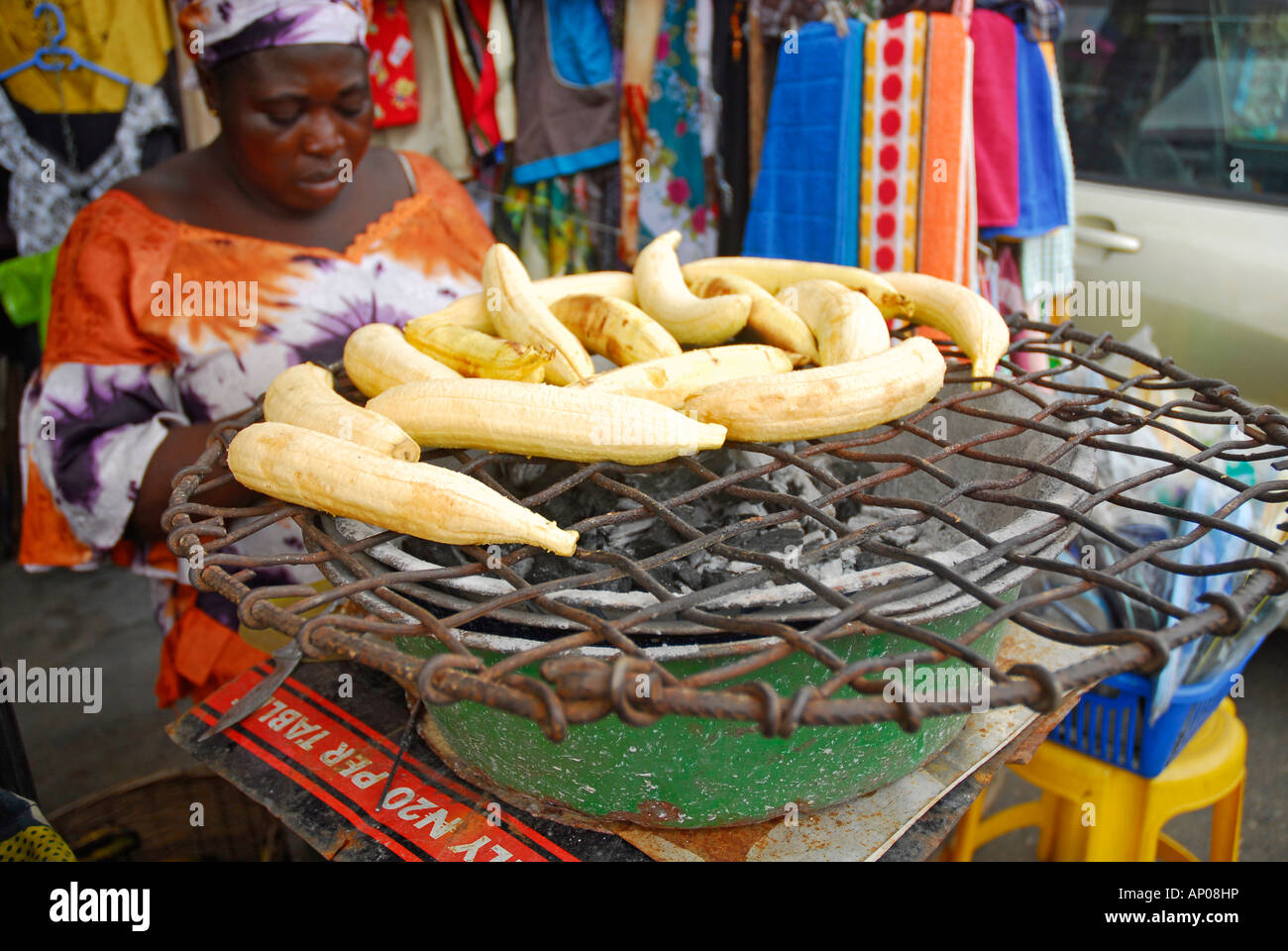 Roasted Plantain (Boli) Seller. Traditional Nigerian Snack of roasted ...