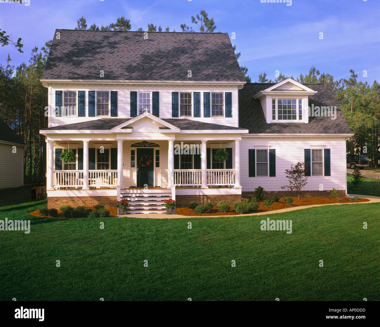 Large White Two Story House With Blue Shutters A Front
