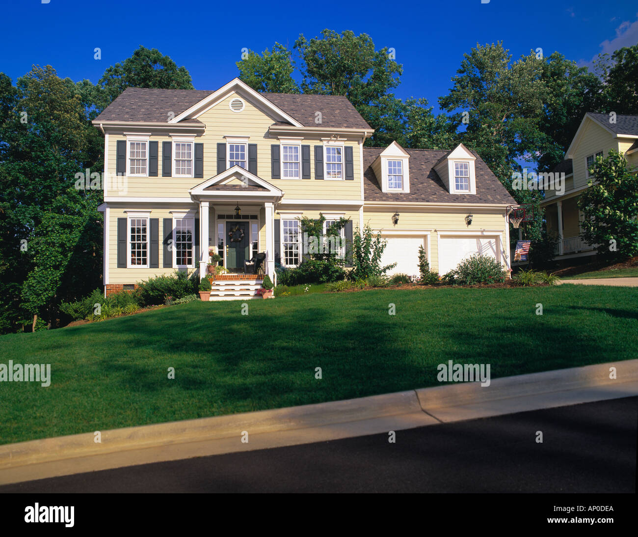 Large two story tan house with green shutters white trim for White house green trim