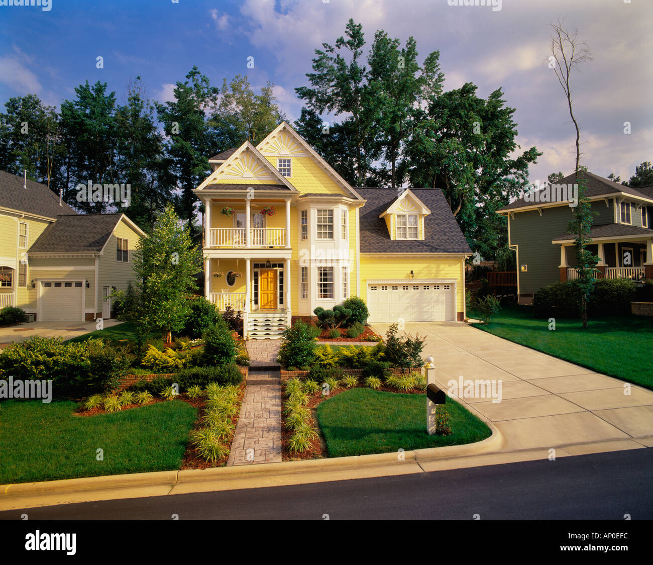 Front Porch Of Yellow House Stock Photo: Front View Of A Large Two Story Yellow House With White