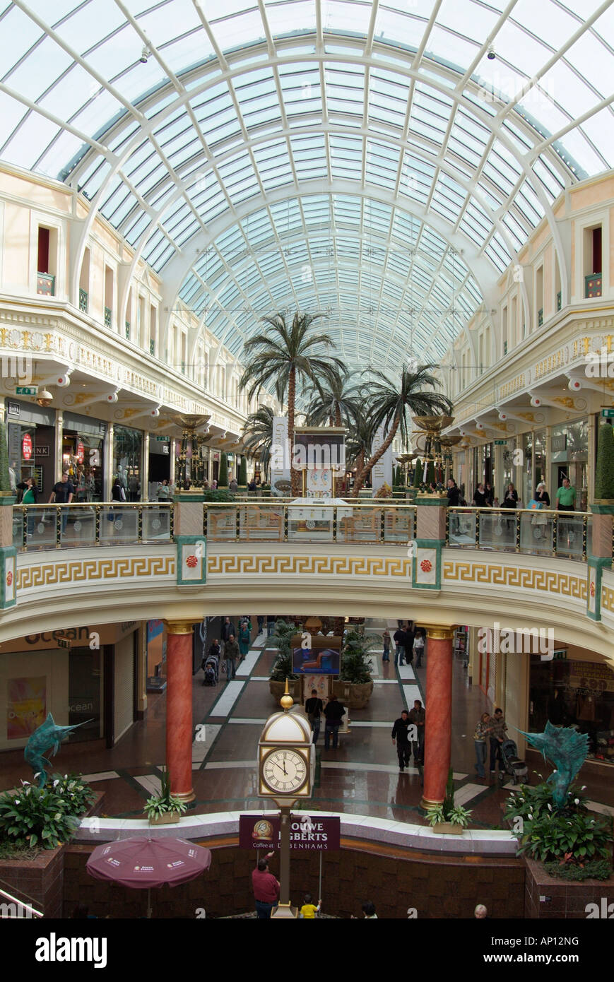 Stock Photo   Trafford Centre Manchester Main Concourse Mall Glass Roof  Palm Tree Clock Elevated Balcony Inside Enclosed Indoor Interior UK