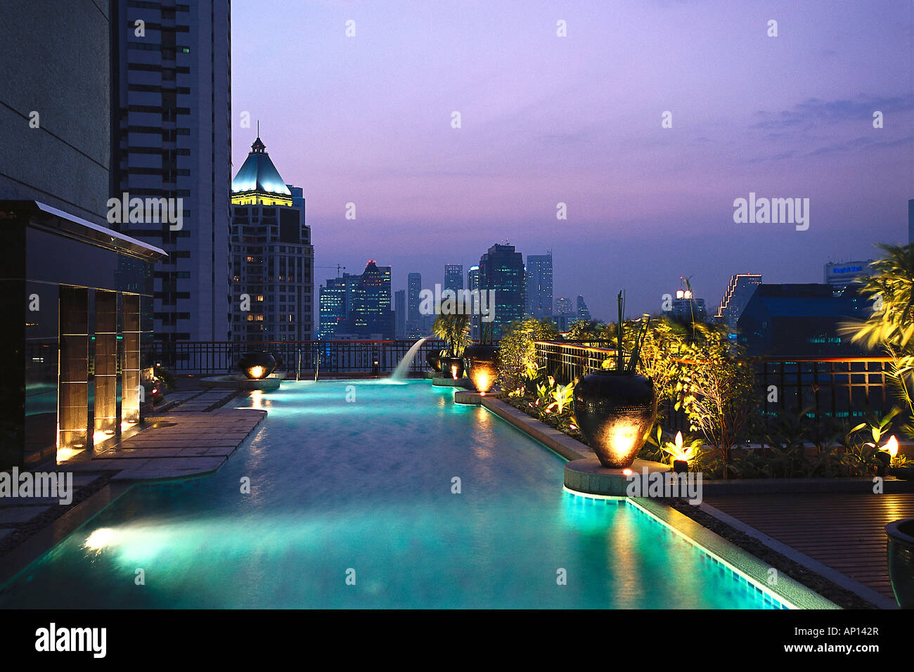 Illuminated pool on the roof of Hotel Banyan Tree, Bangkok ...
