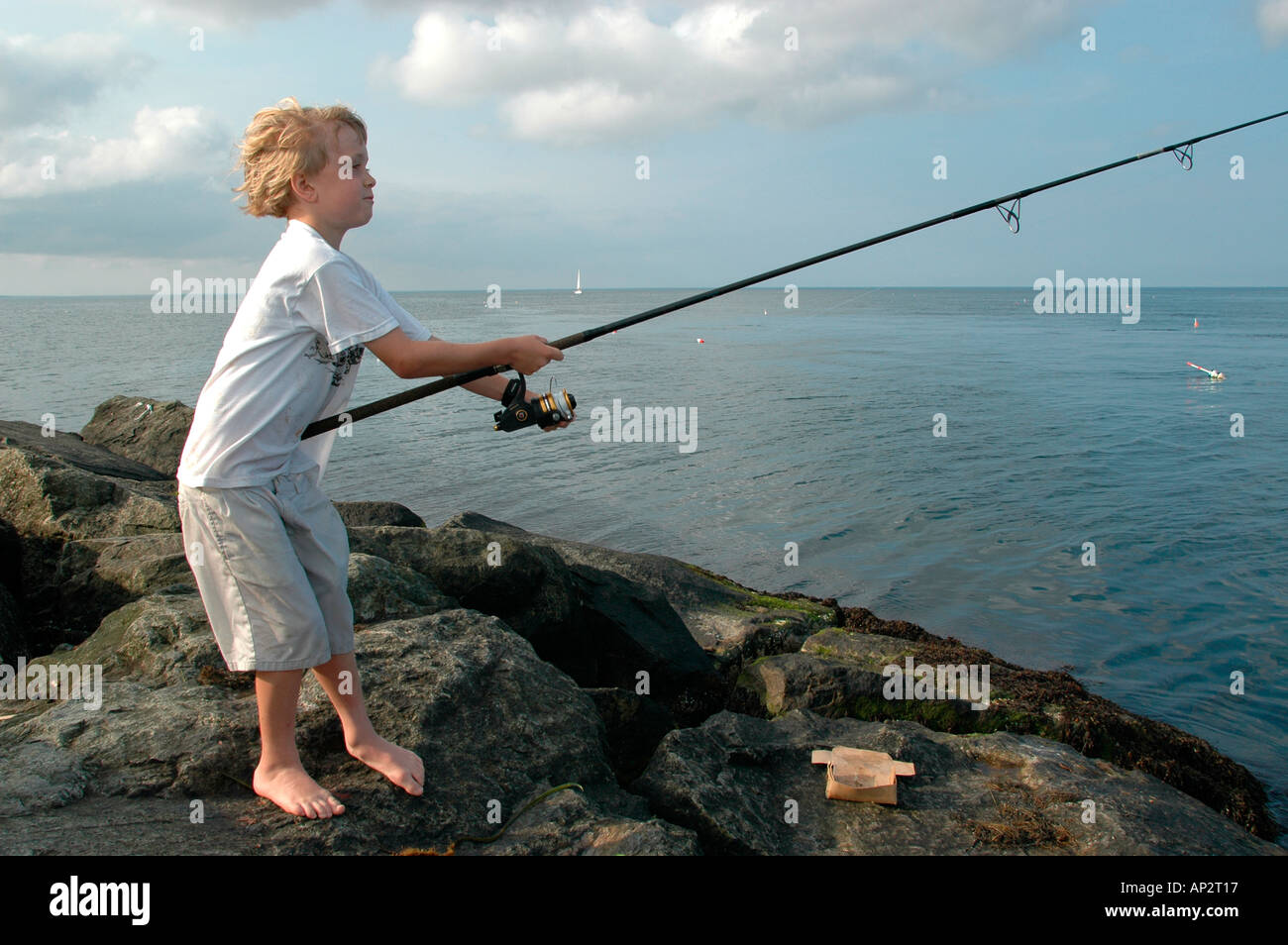 Young boy fishing off the jetty at cape cod canal scusset for Cape cod fishing