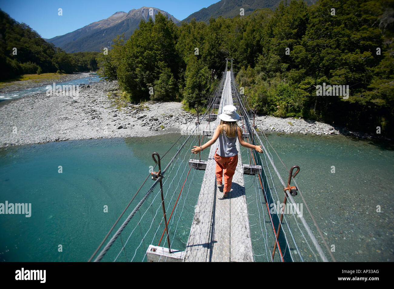 girl on hanging bridge, track to blue pools, east of haast pass