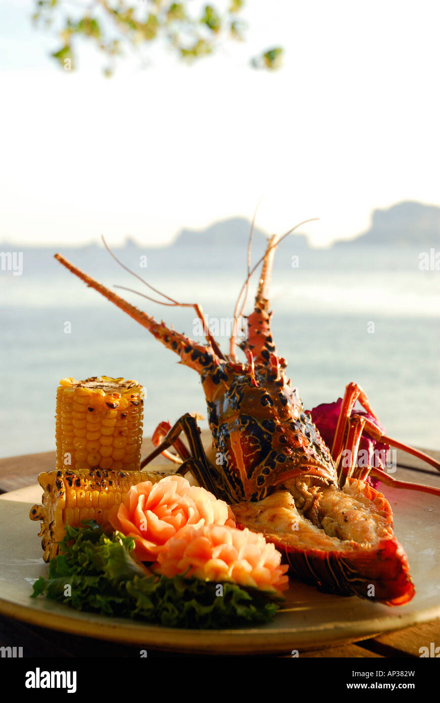 Spiny Lobster dish with sweetcorn at Beach Restaurant The Grotto and Stock Photo, Royalty Free ...