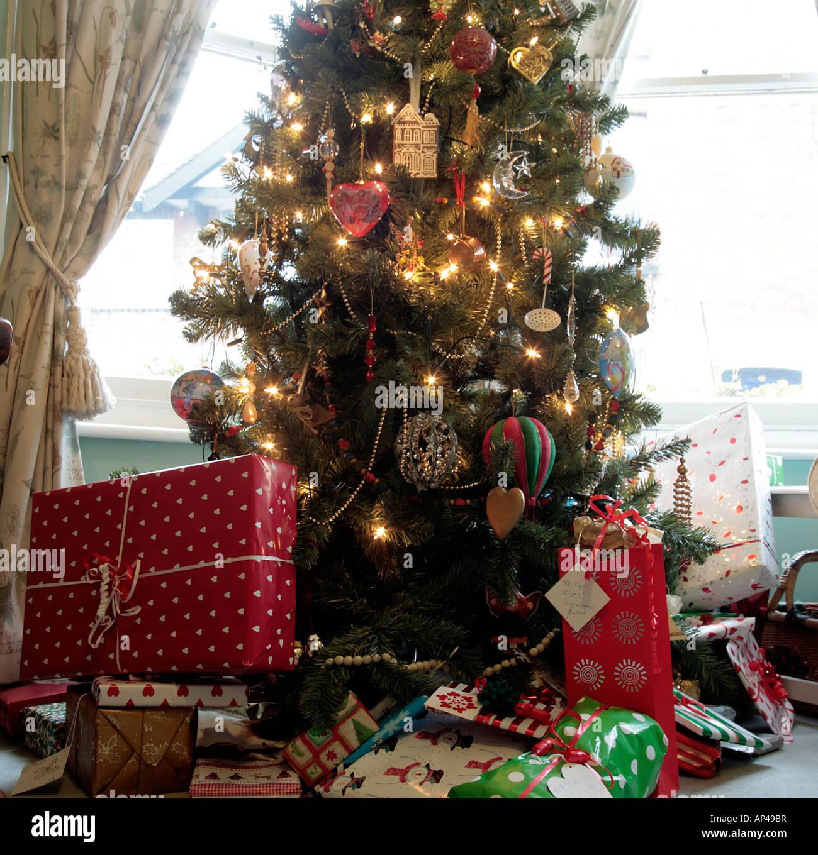 Christmas presents underneath a Christmas tree Stock Photo ...