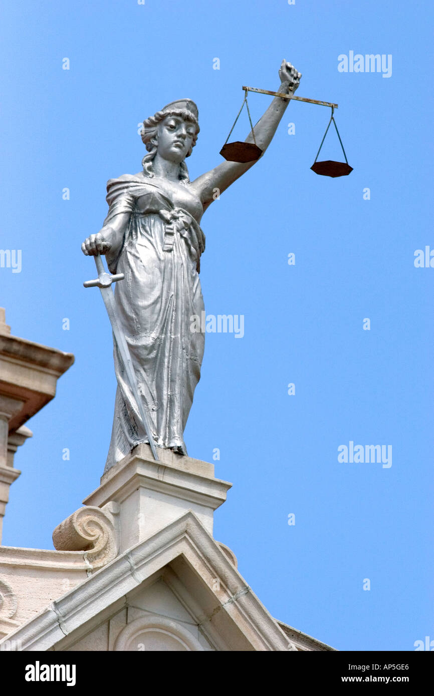 Lady Justice statue with scales of justice on top of the ...