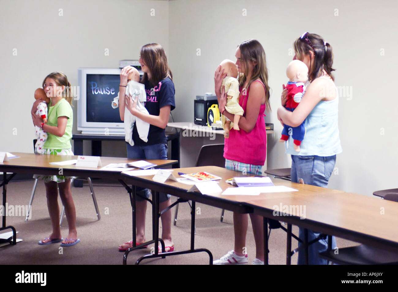 School children on a certified course for babysitting at the school children on a certified course for babysitting at the american red cross center in port huron michigan mi xflitez Images