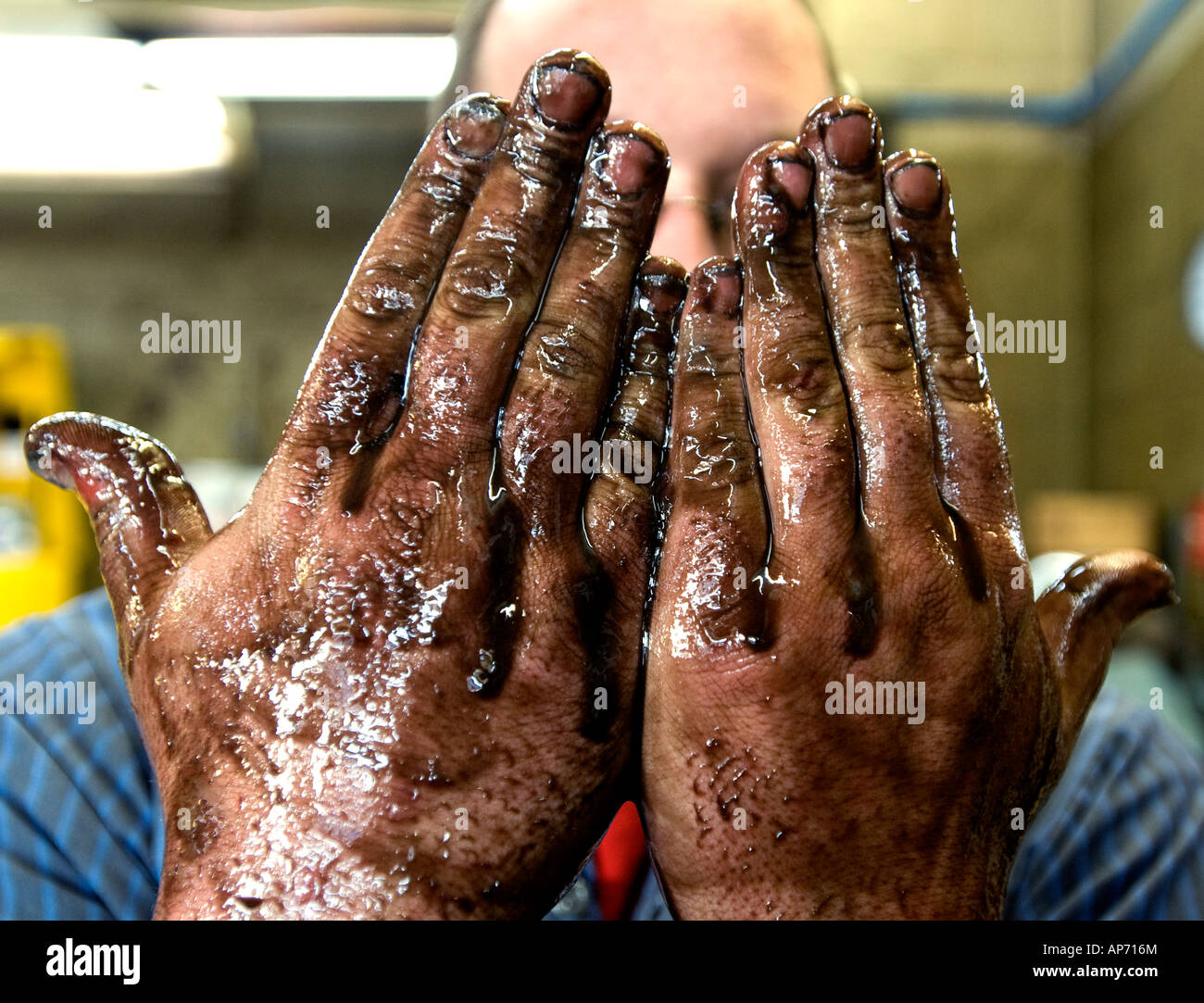 Hands On Garage : Workman s hands covered with oil in front of worker