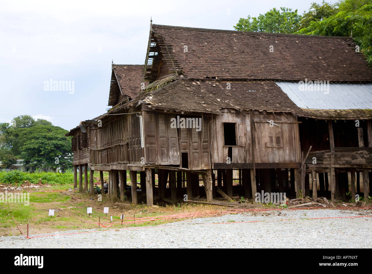 Old traditional wooden teak house on stilts in chiang mai for Thai classic house