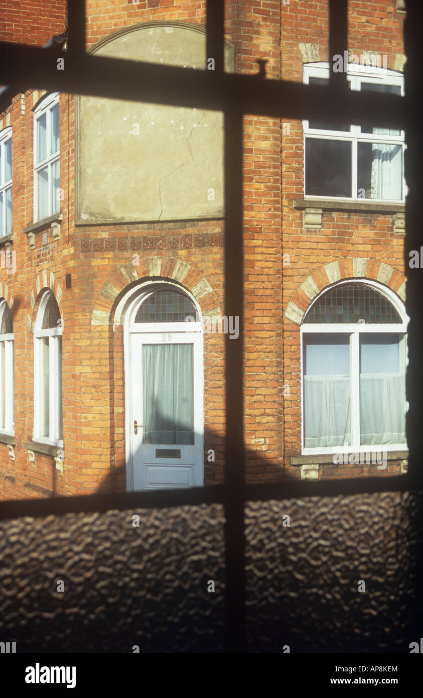 View Through Sash Window With Some Frosted Panes Across Street To ...