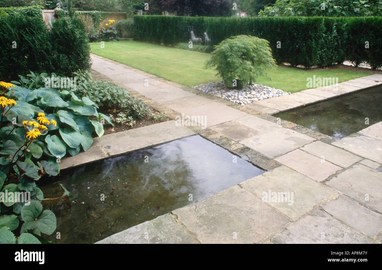 Stock Photo   Stone Paved Path Between Two Rectangular Ponds In Large  Country Garden