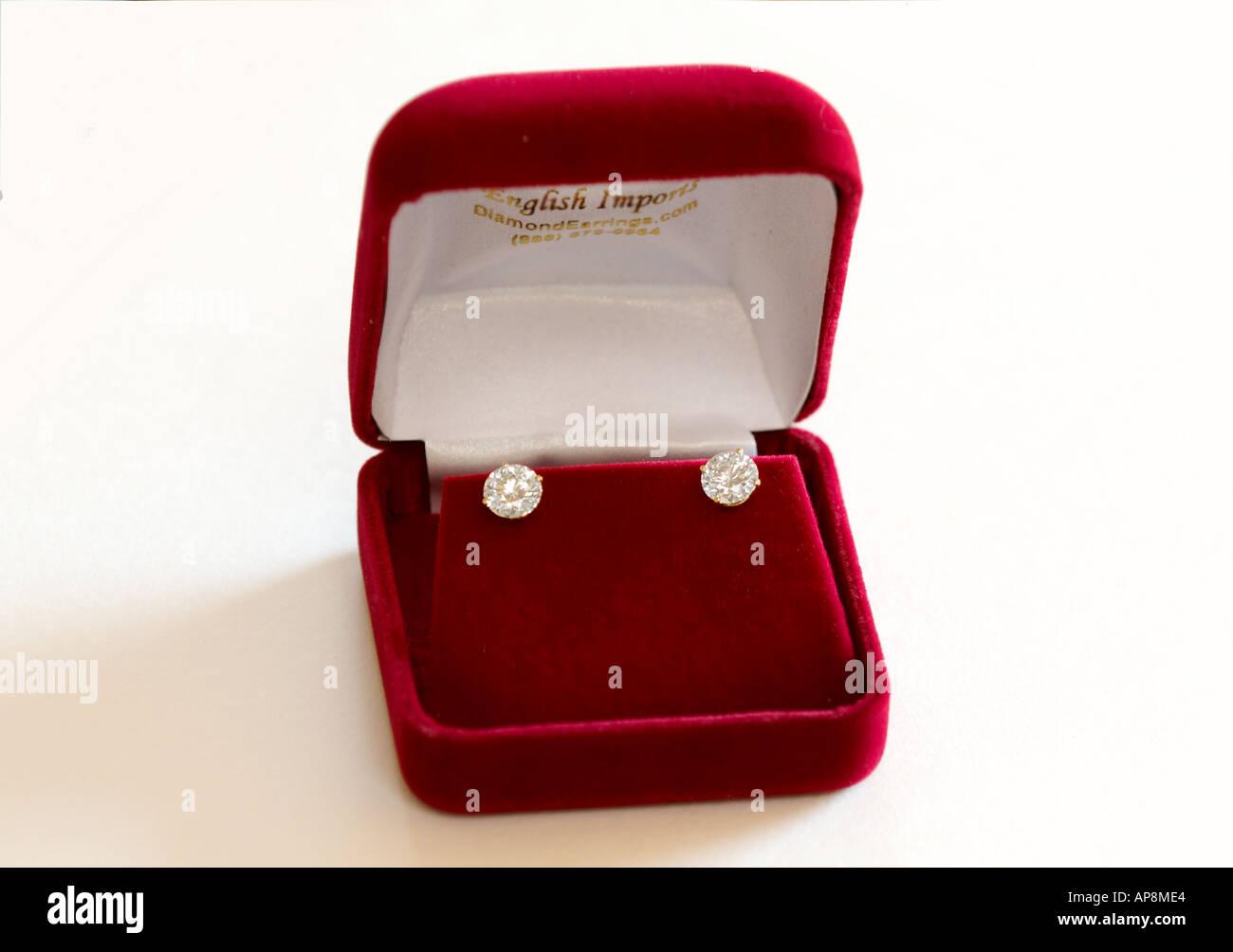 Diamond stud earrings set in a red velvet gift box stock for Red velvet jewelry gift boxes