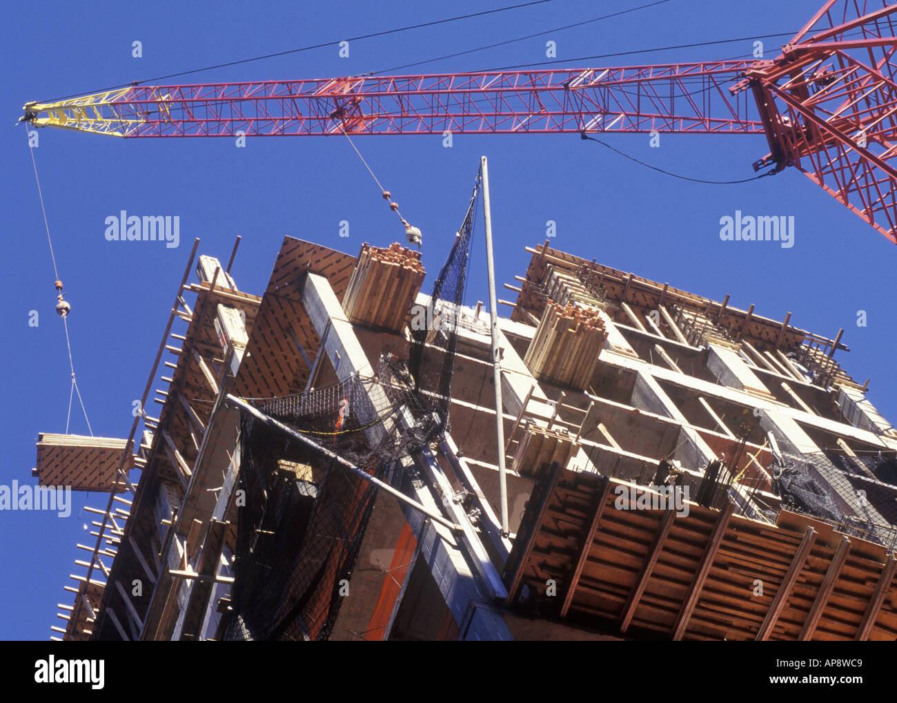 Apartment Building Construction construction commercial building development under stock photos
