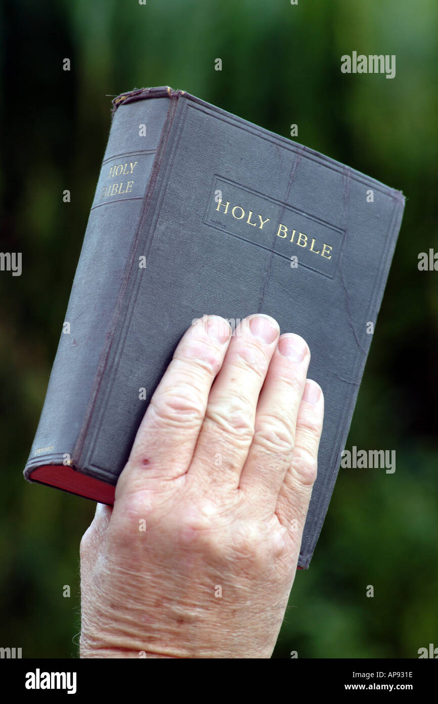 holy bible in hand christian book stock photo royalty free image