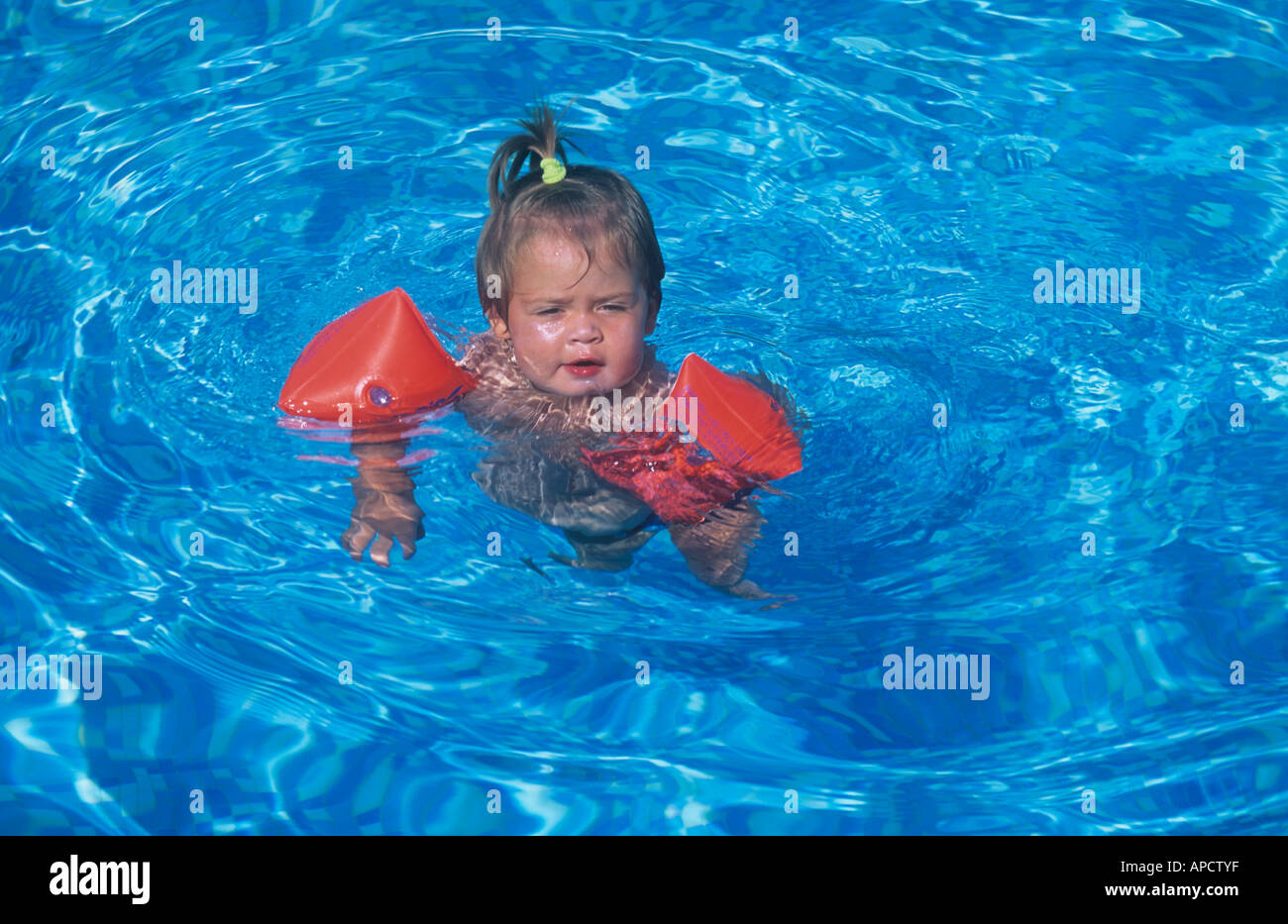 Swimming Pool Wings : Baby girl age months in swimming pool with water