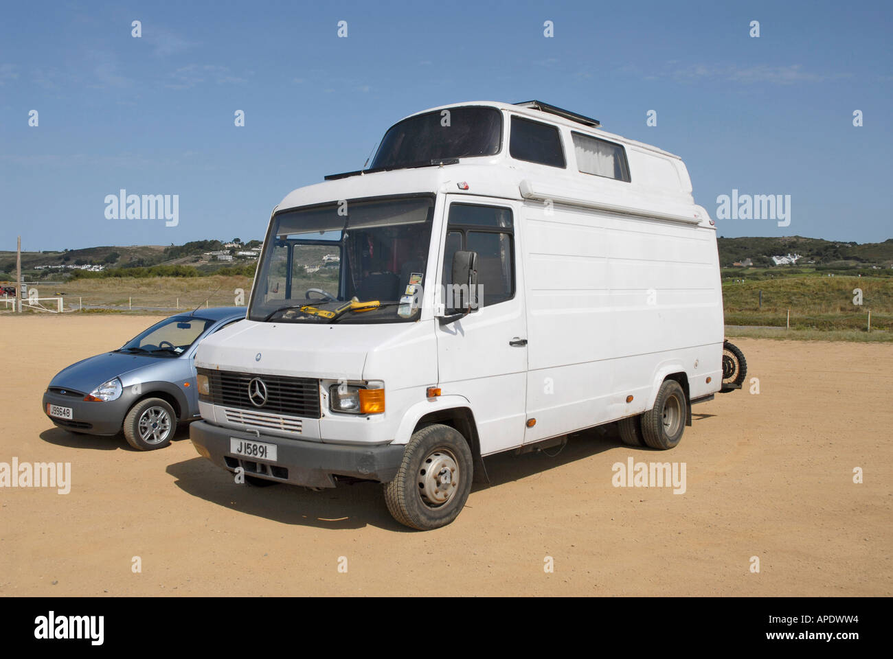 Stock Photo   White Mercedes Van With VW Camper Extension On The Roof
