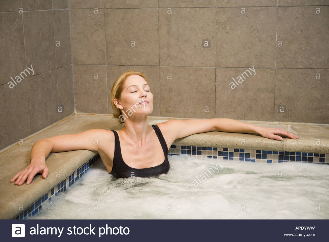 woman sitting in hot tub stock photo royalty free image 15761508 alamy. Black Bedroom Furniture Sets. Home Design Ideas
