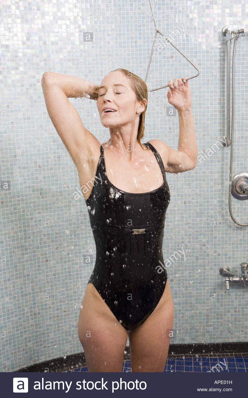 Woman in bathing suit taking shower Stock Photo, Royalty Free ...