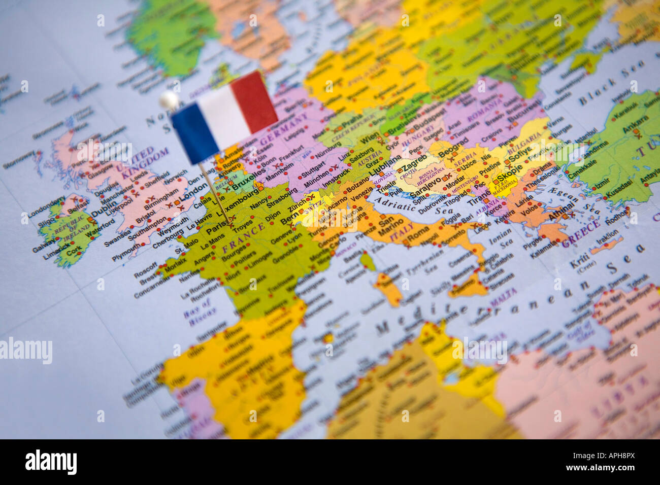 Flag pin placed on world map in the capital of france paris stock flag pin placed on world map in the capital of france paris gumiabroncs Choice Image