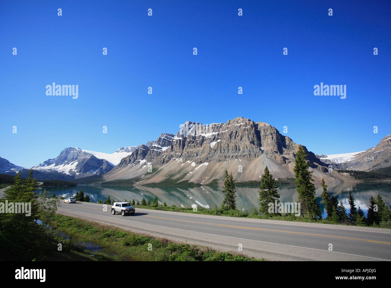 View across turquoise waters of Bow Lake in summer Banff National