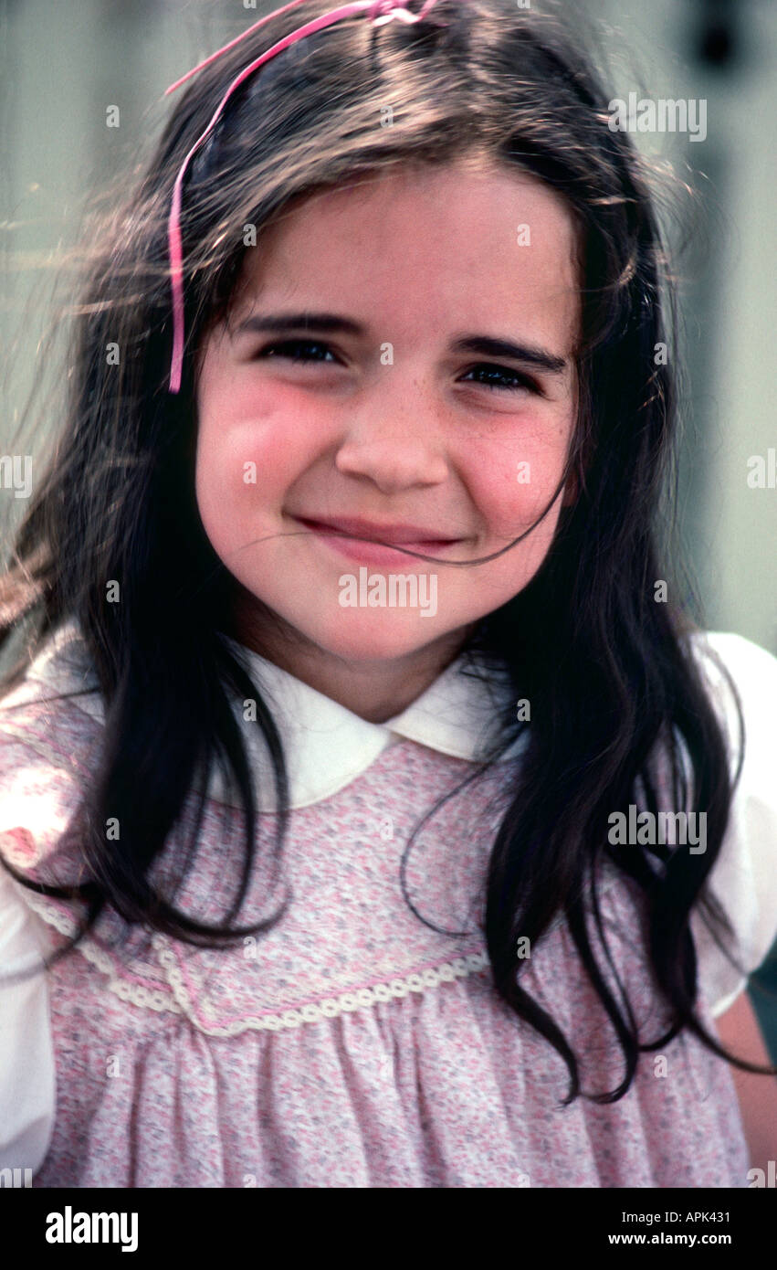 Beautiful 5 Year Old Girl With Dimples And Long Brown Hair