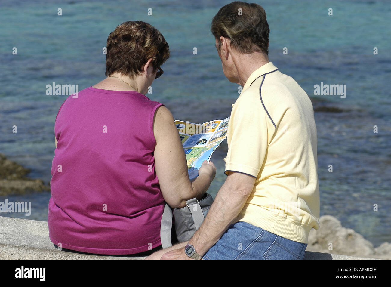 Tourists looking at a map Mallorca Majorca Spain Balearic Islands