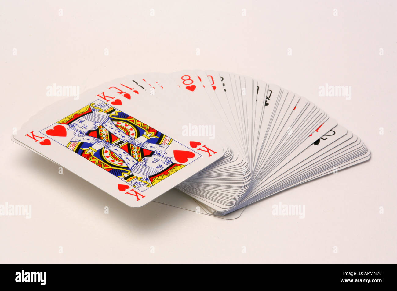 new pack deck of playing cards with the king of hearts