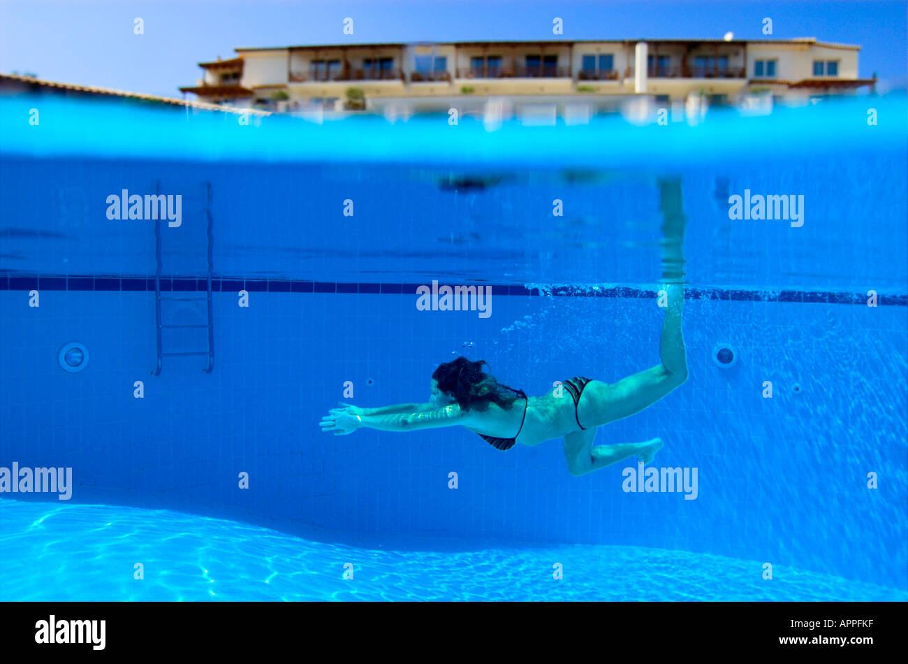 Woman In Bikini Underwater In Swimming Pool Hotel Above Water Stock Photo Royalty Free Image