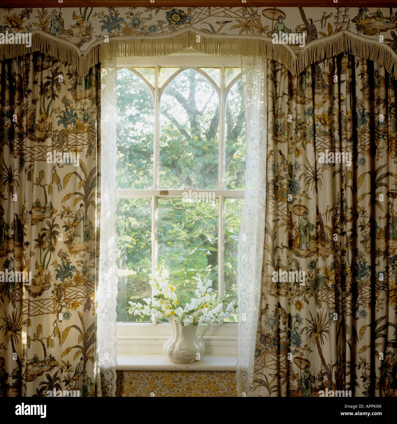 Cottage curtains - Stock Photo Window Of Cottage With Patterned Oriental Curtains And Pelmet