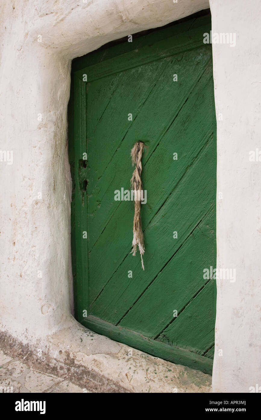 Stock Photo of Small Green Door and Rope Doorknob Stock Photo ...