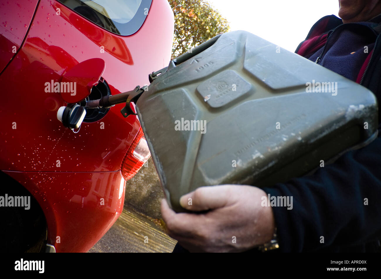 Filling A Car With A Jerry Can