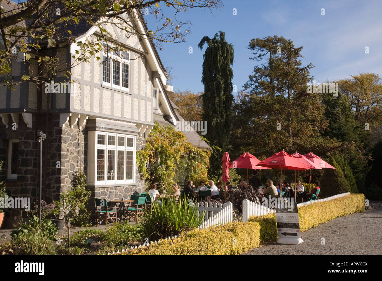 People Sitting Outside Curator S House Restaurant Cafe In Hagley Park Christchurch South Island New Zealand