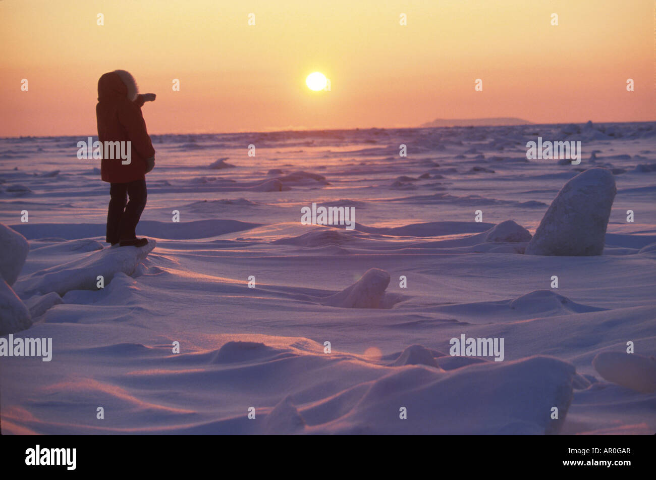 person in parka viewing bering sea nome western ak winter scenic